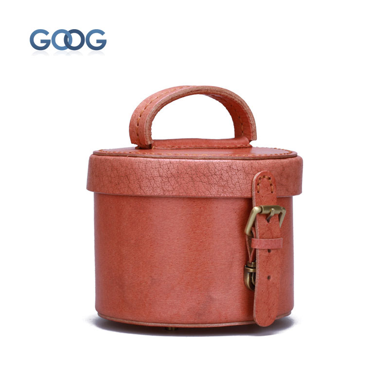 Retro handmade solid color hand - held women 's bag cylindrical makeup bag head layer of leather belt buckle buckle retro women s crossbody bag with solid color and buckle design