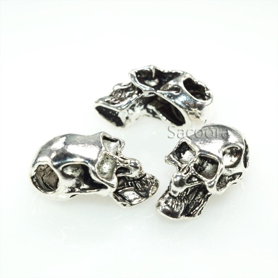 100 pièces Double trou charme métal crâne perle pour Paracord couteau longes argent