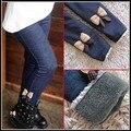 Promoção de inverno crianças meninas Leggings Bowknot Jeans crianças calças elásticas Leggings cintura de lã cashmere inverno crianças roupas