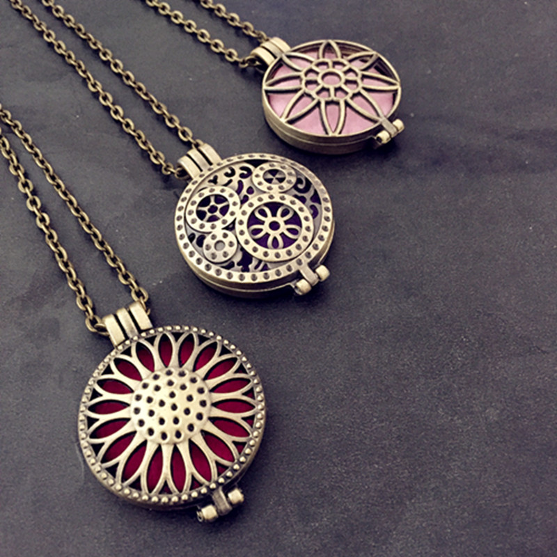 Sunflower locket can open pierced filigree antique bronze essential sunflower locket can open pierced filigree antique bronze essential oil aroma diffuser necklace with colorful pads in stock in pendant necklaces from aloadofball Gallery