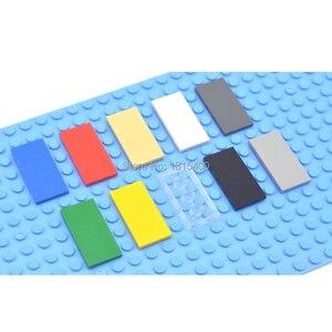 Image 1 - 啓発ブロック建物のレンガのおもちゃスーパーヒーローレンガと互換性 legoes タイル 2 × 4 フラットプラスチック diy のおもちゃ子供 50 個