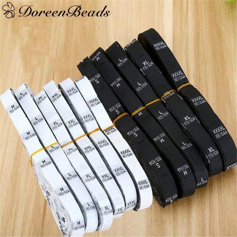 """DoreenBeads размер этикетки одежда тканые бирки XS-2XL белый черный 32 мм(1 2/"""") x 12 мм(4/8"""") 1 рулон(около 400 шт"""