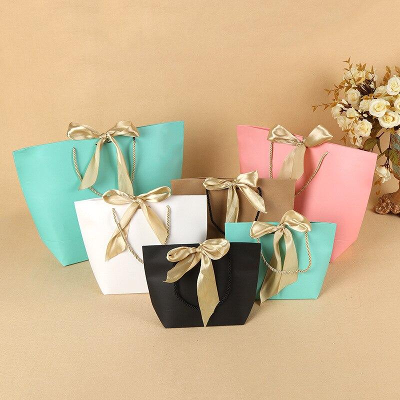 250 pièces présent boîte pour pyjamas vêtements livres emballage or poignée papier boîte sacs Kraft papier cadeau sac avec poignées