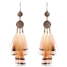 Купить с кэшбэком Vintage flower alloy feather earring Boho ethnic long feather dangle earrings for women Fashion jewellery 2019