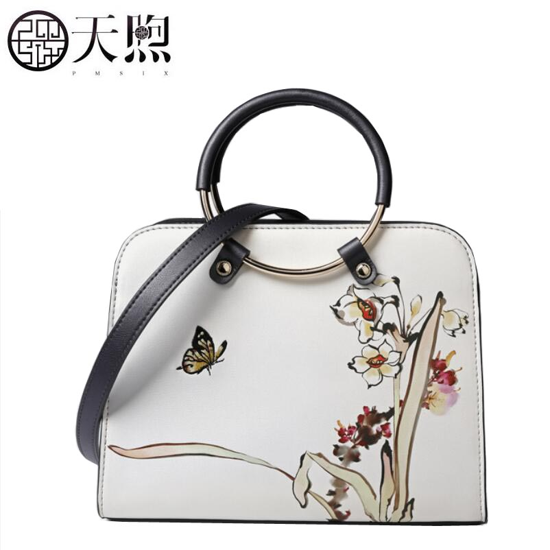 Pmsix2018100% High-quality luxury leather fashion luxury brand new embroidery ring handbag national wind leather Messenger shoul
