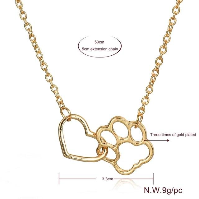 женское ожерелье с подвеской в виде собачьей лапы золотистого фотография