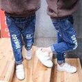 Cuhk desgaste de los niños de la primavera de los niños modelo de la edición de han boy estilo caliente pantalones vaqueros de moda del ventilador luz azul agujero