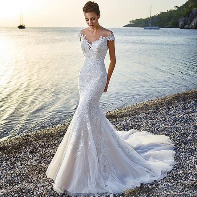 6efe1c7b1bac Sexy Lace Appliques Wedding Dresses Sweep Train Capped Sleeves Sequined  Backless Sexy Bridal Dresses Mermaid Beach Wedding Gowns