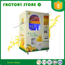 Zewnętrzny ekran dotykowy na monety samoobsługowy automat sprzedający sokowirówka do pomarańczy tanie tanio SASO AT-OVM 220 v NoEnName_Null STAINLESS STEEL juicing vending 0 88KW orange juicer dispenser 2000*1300*980mm 340KG 220V