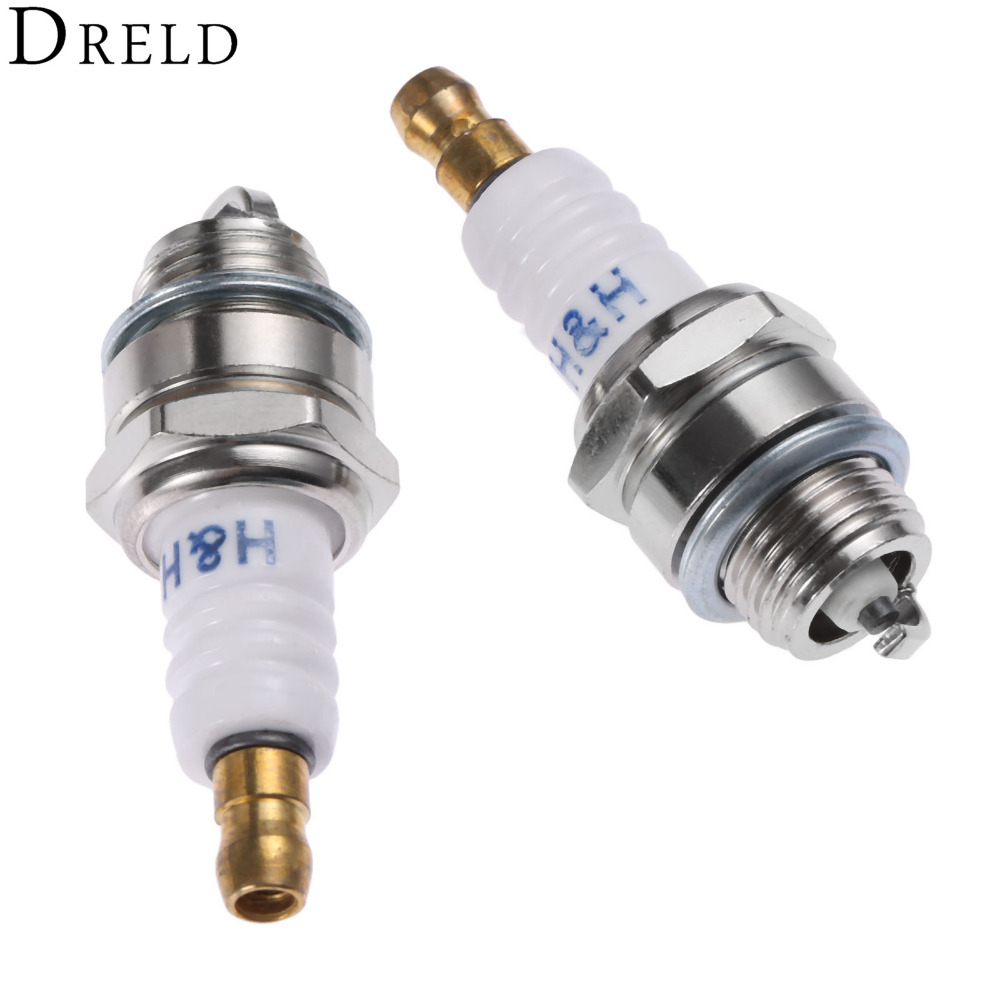 DRELD 2Pcs L7T Chainsaw Spare Parts Brush Cutter Spark Plug For 2 Stroke Strimmer Chainsaw Lawnmower Trimmer Cutter Tool Parts 070 gasoline chainsaw spare parts shround