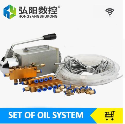 Un ensemble de pompe à huile lubrifiante à main CNC routeur électromagnétique lubrification pompe lubrificateur corps en acier inoxydable
