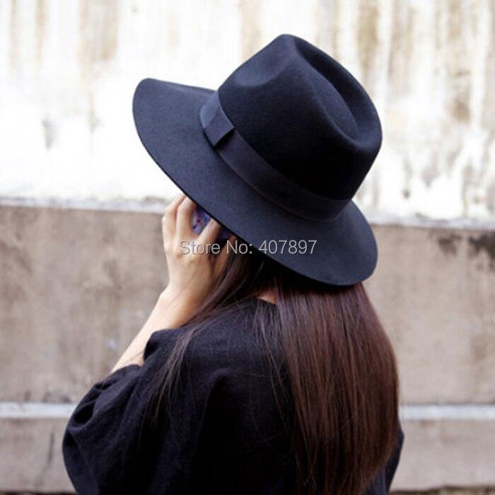 04b368009c4 Autumn Winter Fashion female wide brim black fedora jazz hat casual all  match wool felt hat woolen hats for women free shipping-in Fedoras from  Apparel ...