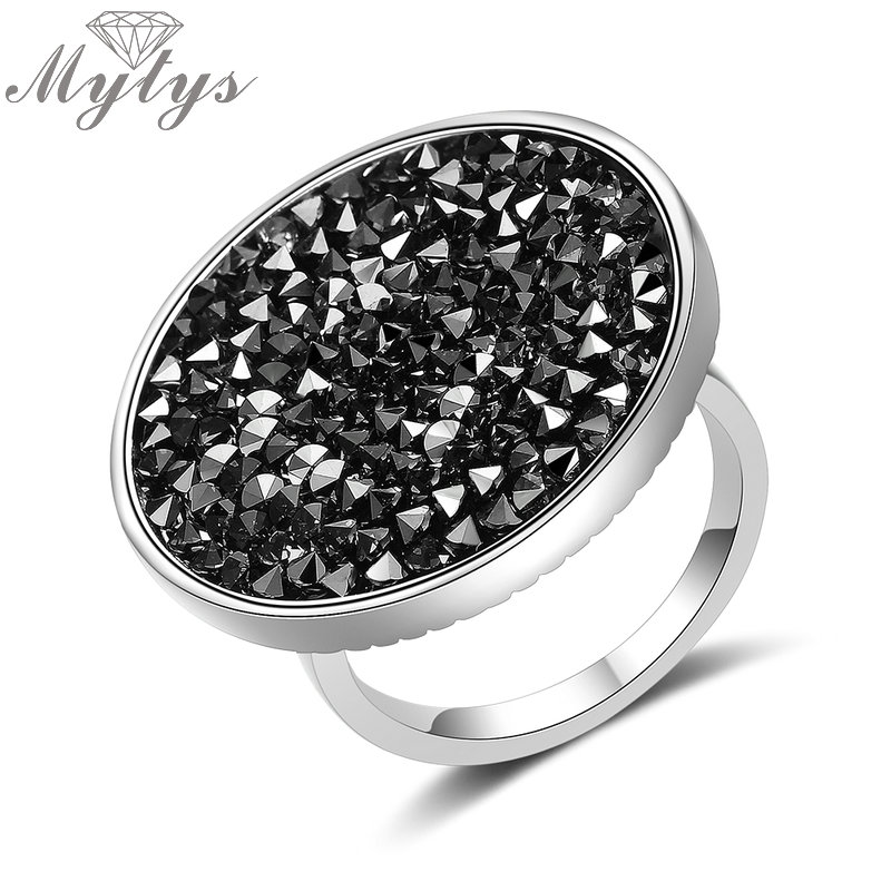 Mytys New Arrival Brand Crystal Ring for Women Pave Setting Black Crystals Big Flat Round Surface Cocktail Statement Rings R2003 new arrival gold color ring bijoux 14mm width big pave setting cz cross x ring for women trendy crystal jewelry wholesale gift