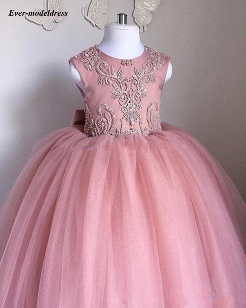 Купить с кэшбэком Lovely Flower Girl Dresses 2020 O-Neck Ball Gown Big Bow Appliques Long Little Pageant Gowns Girls First Communion Gowns Cheap
