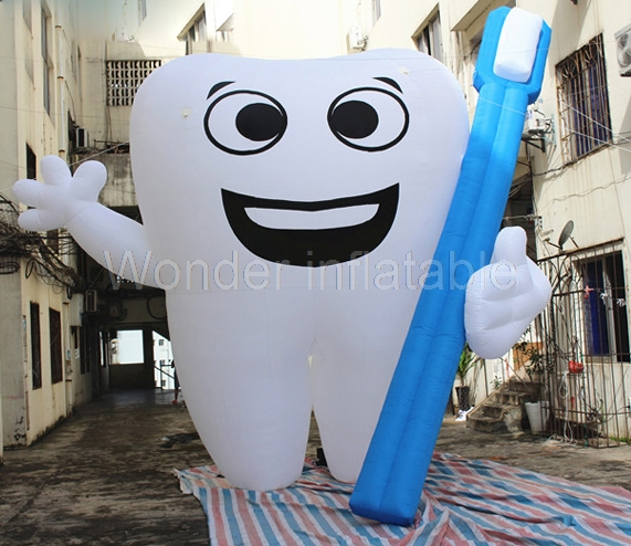 Custom made cheap giant inflatable tooth with toothbrush/ inflatable teeth model for advertising image
