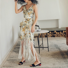 цена на Spring and summer new style V-neck floral dress Bohemian bag hip dress fringed dress