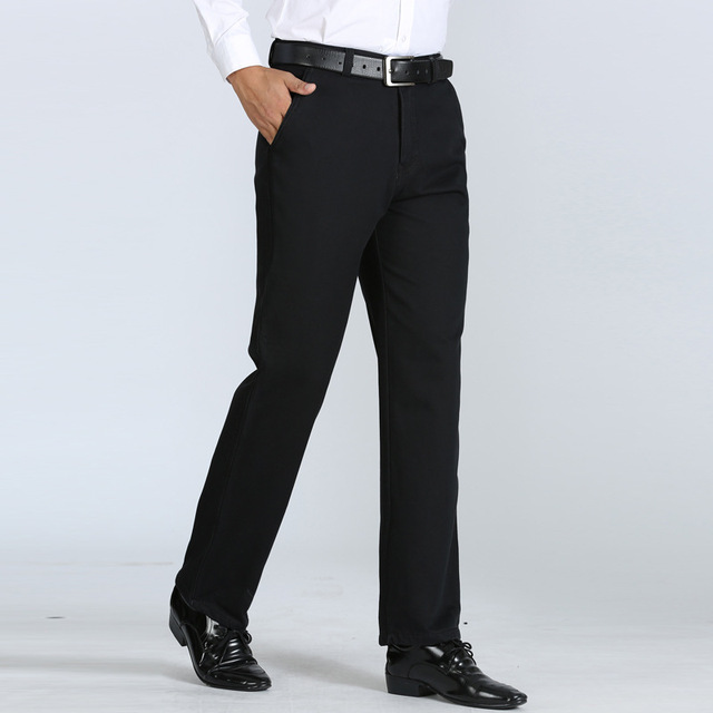 Nuevos hombres de temperamento y de terciopelo para mantener el calor en invierno de la moda clásica Marca de clothin loose pantalones pantalones ocasionales de los hombres