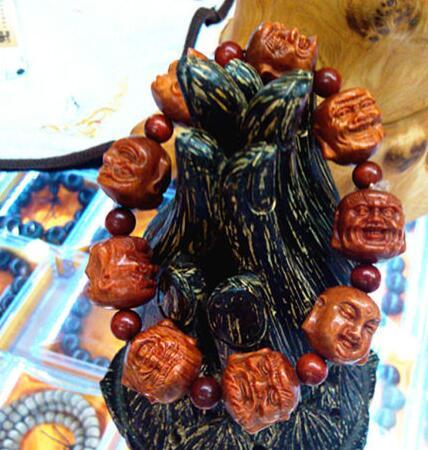 купить free shipping 20mm Man's Natural RAJA KAYU Wood Buddha Beads Bracelet Double-face Buddha Head по цене 5339.95 рублей
