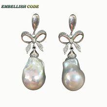 Barocco perle di Bowknot di stile nobile ciondola gli orecchini bianco fiamma di colore della sfera del nucleato perla dacqua dolce per le donne