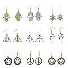 2018 Hot New Fashion Vintage Retro Bijoux Peace Snowflake Anchors Hand Triangle Dolphin Dangling Drop Earrings For Women Jewelry(China)
