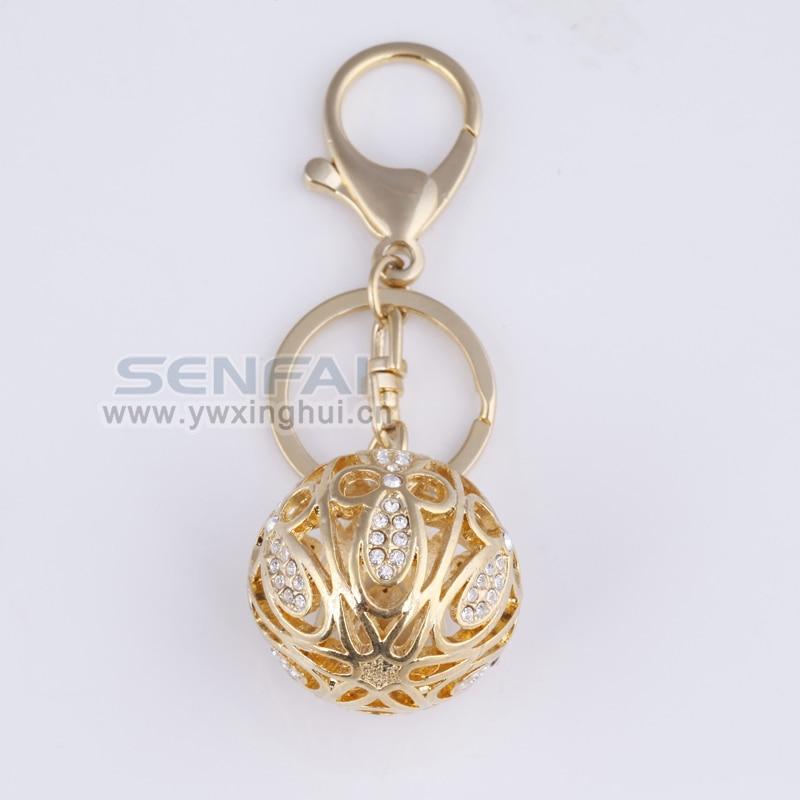 Hot Selling Novelty 3D Ball Keychain High End Gold Hollow Ball Car Keychain Handbag Hanger Keyring for Women, Creative Trinket