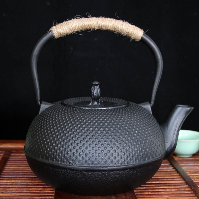 Free shipping big size special 0.9L granule black iron teapots, hotsaleStainless steel infuser no coating cast iron teaset