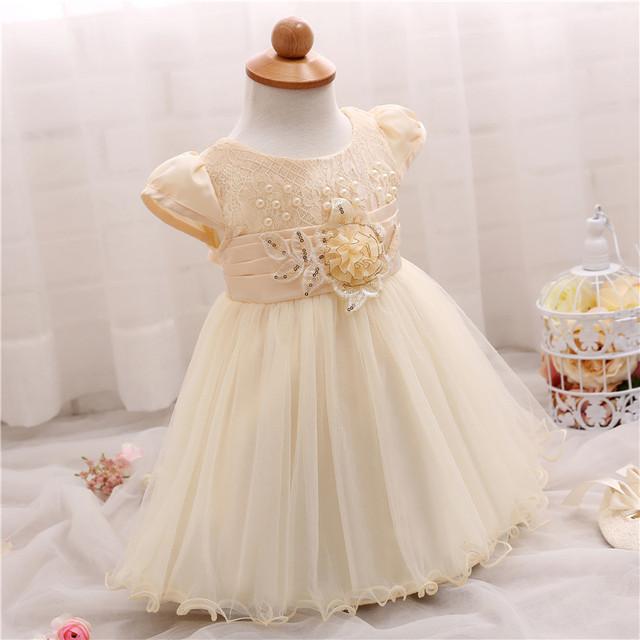 Cream Baby Girl Dress with Beads