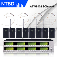 Tüketici Elektroniği'ten Mikrofonlar'de NTBD Sahne Performansı Konferans Hoparlör Hip Hop Yüksek Kalite 8 Kanal ATW8002 Profesyonel Kulaklık Mikrofon Sistemi