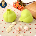 garlic peeling device creative practical kitchen tools magic silicone garlic style household food grade green color