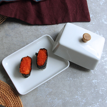 White ceramic sushi small dish fruit compote fine cuisine exquisite dribbling cover butter