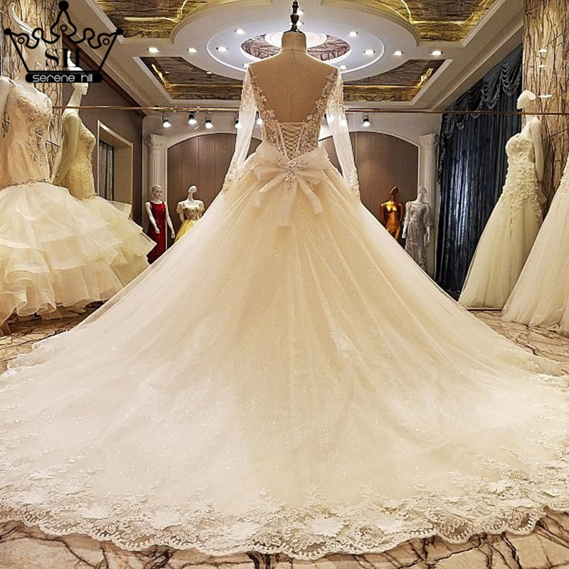 Aliexpress buy gorgeous off shoulder long sleeve low back aliexpress buy gorgeous off shoulder long sleeve low back wedding dresses 2017 new arrival sheer beaded ball gown bridal gowns robe de mariage from junglespirit Gallery