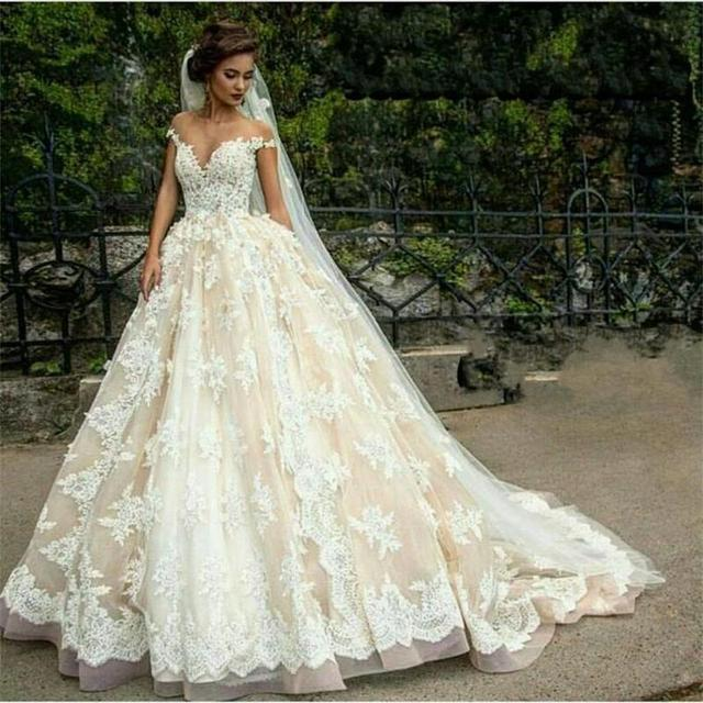 ed61c54e8 Fantastic Tulle Bateau Neckline Ball Gown Wedding Dresses With Lace  Appliques Champagne Court Train Bridal Gowns
