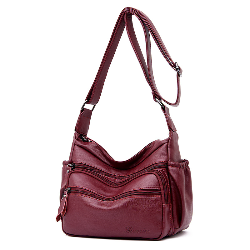 New 2019 new water bag European and American fashion one shoulder leather bag dray red zipper