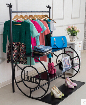 Clothing display shelf. Clothes tree. Hanging clothes rack. Clothing store shelves display stand.