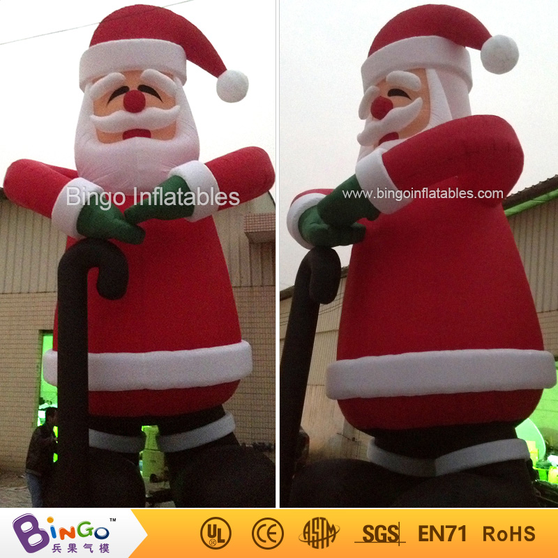outdoor christmas inflatable santa claus with crutch 8m high factory direct sale BG-A0376 toy 5m high big inflatable christmas santa claus climbing wall decoration 16ft high china factory direct sale festival toy