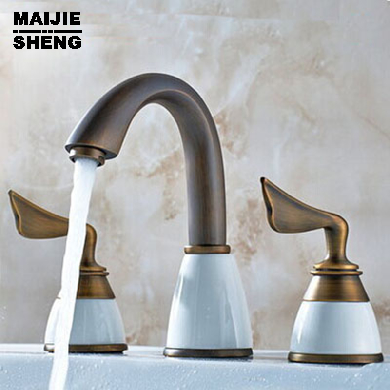 Double handle Three holes bathroom faucet antique brass sink taps basin mixer hot and cold water mixer tap basin faucet split faucet soft jade gold brass made cold hot switch double handle bathroom shower room three hole mixer taps