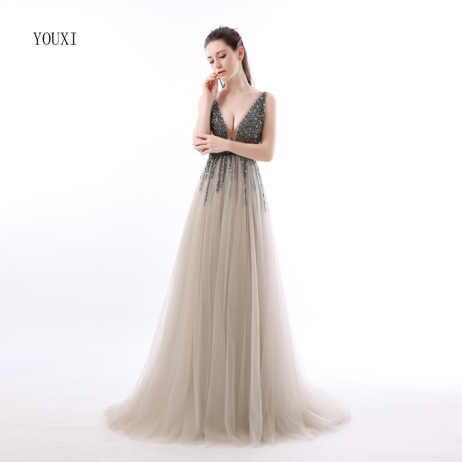 купить  Sexy Side Split Prom Dresses 2018 Deep V-Neck Backless Beads Crystal Party Gowns Sleeveless Sweep Train Cheap Tulle Party Dress по цене 6425.76 рублей