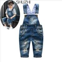 Shuzhi新しい春distrressed子供ジーンズ穴赤ちゃん男の子女の子のジーンズ子供デニムオーバーオールファッション子供サスペン