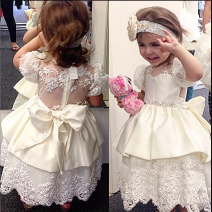 Cute Baby Birthday Party Gowns with Bow Lace Short Sleeves Custom Made First Communion Gowns Sheer Back and Neck Ankle-LengthCute Baby Birthday Party Gowns with Bow Lace Short Sleeves Custom Made First Communion Gowns Sheer Back and Neck Ankle-Length