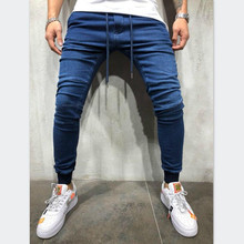 цены на 2019 autumn new European and American men's denim fabric casual sports pants beam feet trousers jeans men's casual harem jeans  в интернет-магазинах
