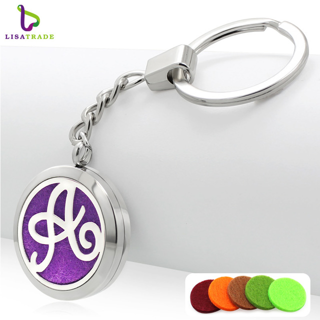 Stainless steel fashion silver cute aromatherapy metal letter keychains  trendy round floating letter keychain for women 5b26a4ae52