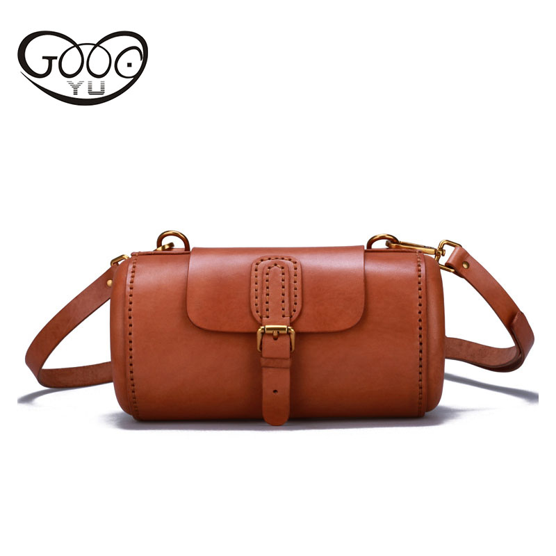 The new cylinder type Messenger bag head layer of cowhide stereotypes personality retro bag wrapped tanning leather multi - purp the new retro hand brush color bag head layer leather casual bag messenger bags wholesale