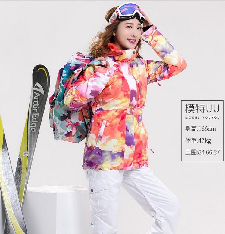 27cfb6563d Women s waterproof 10K snowboarding suit female outdoor sportswear riding  climbing ski suit red ski jacket and white ski pants