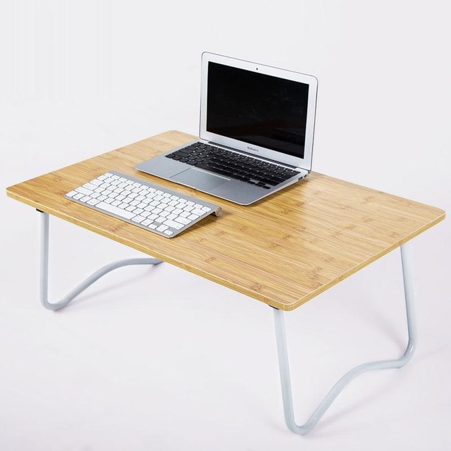 bsdt the notebook comter on bed with simple small lazy table folding