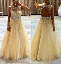Прозрачное платье в пол из фатина с открытой спиной и кристаллами