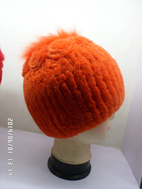 The orange fur rabbit hats with flowers.