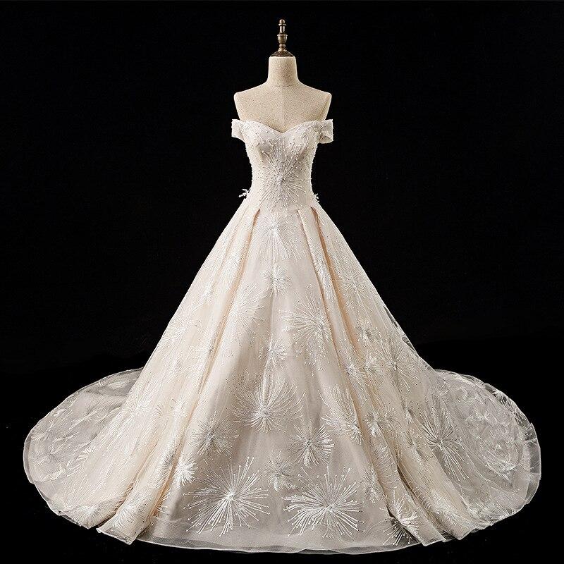 Royal Lace Wedding Dress 2019 Long Train Off Shoulder Princess Champagne Church Wedding Dresses Ball Gown Pakaian Pengantin