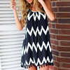 Black White Chiffon Backless Mid Dress with Tassel Hem