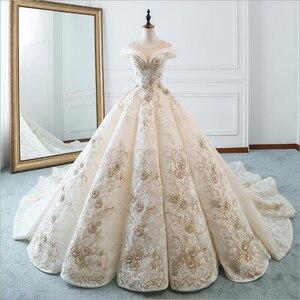 Image 1 - Luxe nouveau bateau cou manches courtes Appliques De luxe perles dentelle robe De mariée pour les robes De mariée De mariage Bridals Vestido De Noiva