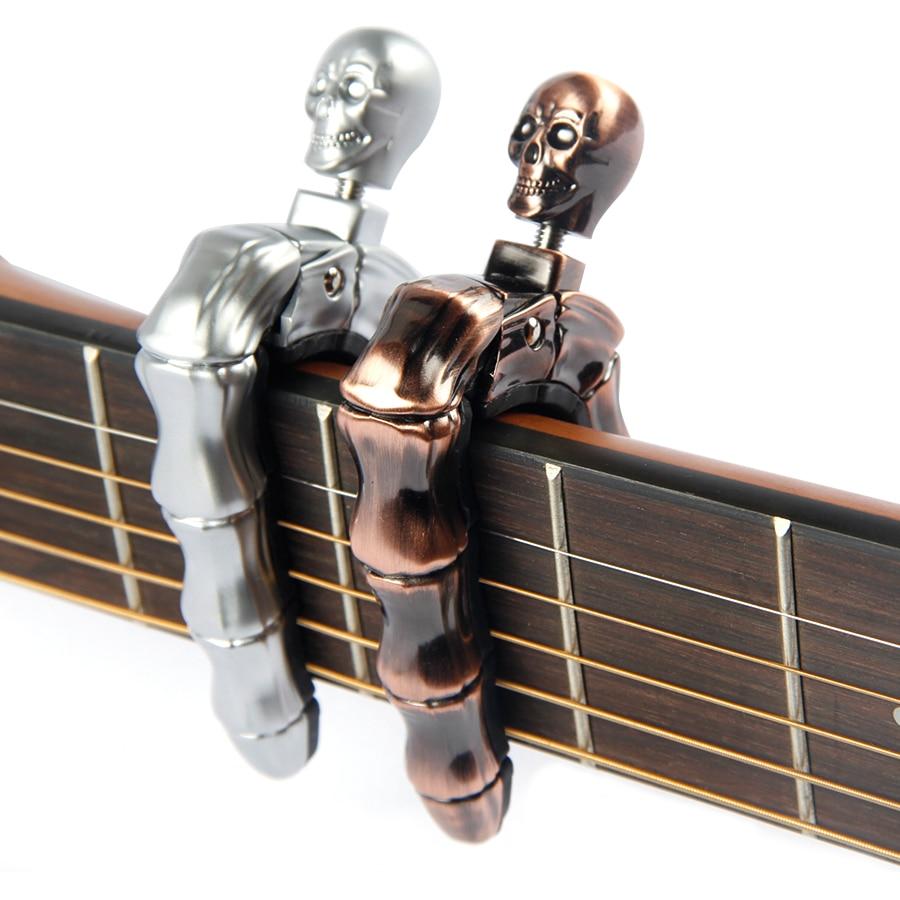 yueko guitar capo skull bass guitar capo folk acoustic electric guitar capo guitar accessories. Black Bedroom Furniture Sets. Home Design Ideas